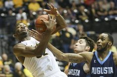 Wichita State's Markis McDuffie fights for a rebound against Augusta's Ja'Shawn Brooks during the first half of their game at Koch Arena on Saturday.