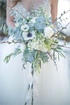 Fabulous winter wedding bouquet! Just look at those blues and greens.
