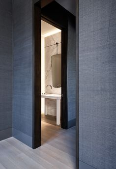 Grasscloth and black trimwork // Bathroom by Design Mastermind Matthew Leverone