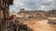 Volunteers and emergency workers search for bodies buried under the debris of one of the temples at Basantapur Durbar Square on April 27, 2015 in Kathmandu, Nepal. (Omar Havana/Getty Images)