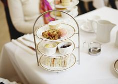 Tea, sandwiches, desserts, and pudding on tier.