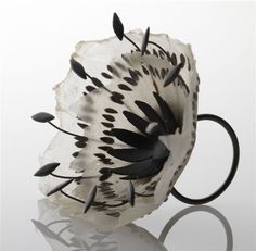 Black Seed Ring by Sabrina Meyns. Uses black seeds, one dandelion seed, handmade paper, and oxidized fine silver