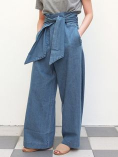 Details  Wide-legged denim trousers made with summer-ready fabrics. Waistband adjustable with the self-tying ribbon.Sits above the waist.  *Lead-time
