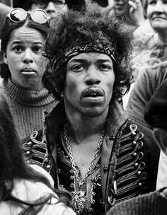 Jimi Hendrix, photobombed by some startled woman who must be wondering why paparazzi are suddenly interested in her.
