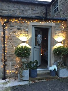 Pretty winter garden porch curbappeal lights garden welcoming christmas is part of Porch garden - Outdoor Christmas, Cottage Front Doors, Front Garden, Christmas Garden, Garden Lighting, Front Door, Winter Garden, Christmas Lights, Front Yard