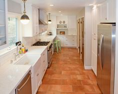 Beautiful Modern Kitchen with Terracotta Colored Tile Flooring: Beautiful Piedmont Kitchen Design Tile Floor White Cabinetry