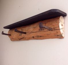 Rustic lodge shelf and coat rack with railroad spikes and reclaimed wood on Etsy, $75.00