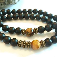 New tiger eye & onyx agate bracelet with bronze accents.   • Your choice of asymmetrical or symmetrical design.   • A great mens gift. Perfect for women too.  • Arrives boxed & bowed for giving.