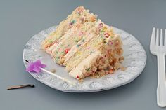 """Momofuku Milk Bar Birthday Cake ~ vanilla and sprinkle cake topped with a generous swirl of that sprinkle frosting. The cake was designed to taste like the typical """"funfetti"""" birthday cake.  With every bite, you can pick out the sweet, salty, and sour notes. The crumbs bring a surprising crispy element to the usual creamy texture of frosting.  The recipe is brilliant and inspiring."""