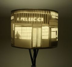 Welcome to Shadey Street This exquisitely made lampshade is from the clever team at Home Slice Design A paper cut lampshade depicting glowing scenes