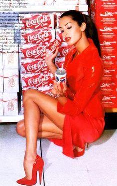 Yasmeen Ghauri posing with my drink of choice in hand.