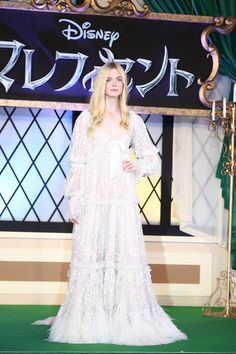Elle Fanning Evening Dress - Elle Fanning totally dressed the part in an elaborate Alexander McQueen fairy-tale gown during the 'Maleficent' premiere in Tokyo.