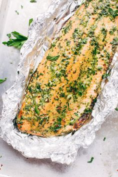 An easy weeknight salmon dinner that's perfect for meal prepping too! This baked salmon in foil is topped with homemade chimichurri sauce.