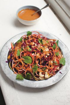 Forget rice noodles – take it to the next level by putting beautifully coloured and vibrant veggies through your spiraliser, and there's no cooking involved! Give it a try and make this raw rainbow pad Thai from The Good Life Eatery cookbook tonight.