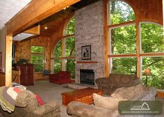 """Mountain Majesty - This Smoky Mountain chalet has all the amenities to make you feel like you are """"king of the mountain"""" and features spacious accommodations, a private setting, designer furnishings, hand-laid stone, hand-crafted natural wood accents and 3 indoor jetted tubs."""