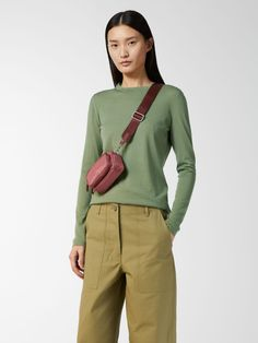 This mini-sized shoulder bag is crafted from a durable and water resistant Cordura nylon, and has a detachable shoulder strap in webbing tape. With a desig
