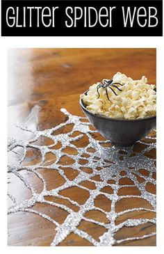 Glitter, glue and wax paper are the tools you need to make this spider web. Very cool for your Halloween decor and especially for your buffet