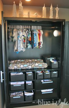 No closet in the nursery, or baby sleeping in the master bedroom? Turn an armoire into a baby central, with a changing station, room to hang the clothes, and drawers for all the other essentials! | from Blue i Style