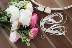 You'll need: 3-4 dozen flowers a wooden embroidery hoop 15-20 yards of assorted ribbon 1-2 yards of lace trim a D ring or plastic ring floral shears a bucket glue gun scissors