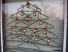 Christmas tree made out of  plastic hangers! I might have to do this in the big window in Ellie's room!