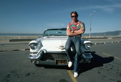 Arnold Schwarzenegger with his vintage Cadillac, 1984