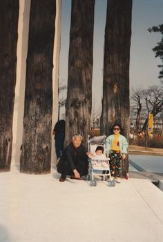 When I was young. With grandfather and cousin wearing sunglasses.
