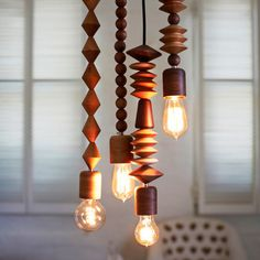 Beautiful hanging lamps, hand-lathed using FSC-certified wood