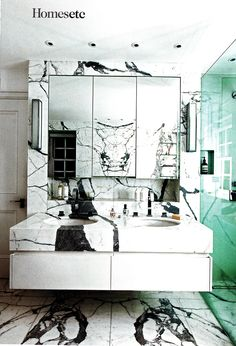 love the nook under the mirror cabinet // marble bathroom living etc