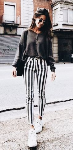 Street style outfits- I love the striped fitted trousers with the slouchy  cosy jumper. Autumn outfits are looking good. 4caac53f5