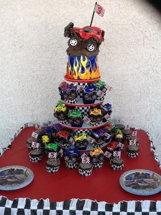 Monster Truck Flame Cake Topped Cupcake Tree..flame cake made by Jane at our local Albertsons, truck and candle top added after. Cream filled cupcakes with Oreo frosting made by my daughter Dodi.