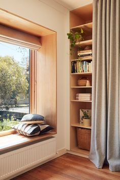 I don't know what I love more. The wonderful window seat opening the house out to garden or tha...