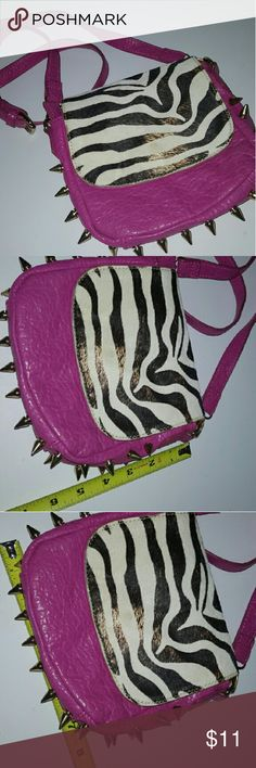 Pink Zebra Spiked Crossbody Zebra print is fading a little Very small in size Measurements above? Adjustable strap Spikes are a little faded Bags Crossbody Bags