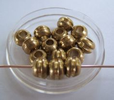 25  Solid Brass  6mm Beads/ Spacers w/Ridge by MugsysBeads on Etsy, $2.50