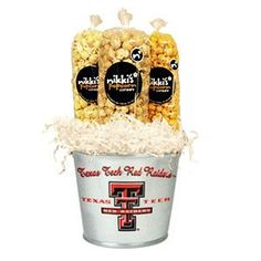 Filled with 3, 9 cup bags of our delicious gourmet popcorn this is a great gift for your Texas Tech fan! 1 bag of Buttery Popcorn 1 bag of Buttery Caramel Popcorn 1 bag of Cheddar Popcorn Bags are pla