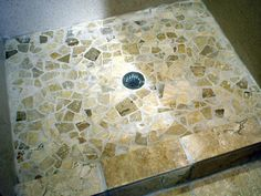 LOVING THIS LOOK FOR MASTER SHOWER - HOW TO TILE A SHOWER FLOOR WITH PEBBLE TILES