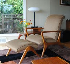 Post-War Architecture: Scandanavian Modern Living Room Teak, washable fabric, a monochromatic color scheme, and the sparse, simple decoration of the Scandinavian Modernist style fit well in minimalist mid-century modern interiors.
