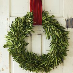 Fresh Olive Branch Wreath. Hang a ring of freshly cut olive branches with grey-green leaves as a symbol of peace and good will. This simple yet stunning wreath comes with vibrant red ribbon for hanging, and will present changing natural beauty as the leaves dry. Wreath measures 24 in diameter. $98