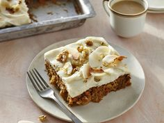 This moist, delicious carrot cake has traditional ingredients like carrot, pineapple, and walnuts, with the addition of toasted coconut...