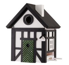 Multiholk from Wildlife Garden combines birdhouse and bird table in the same design, adapted to the needs of small birds combined with the very decorative design of detailed miniature houses. Swedish Cottage, Red Cottage, Homemade Bird Houses, Bird Houses Painted, Bird Boxes, Timber House, Nesting Boxes, Miniature Houses, Mini Houses