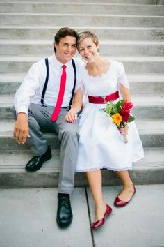 Cute wedding picture and pose. plus i love the splash of bright color on both the bride and the groom!