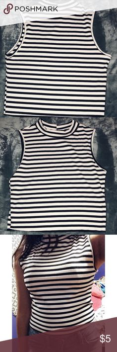 Black and white striped shirt Black and white. Striped shirt. Mock neck. The tag says large but most of my shirts are a size xs/s and this shirt doesn't fit me that big so I would say it's more of a medium. It is stretchy though. Beware Tops Tank Tops