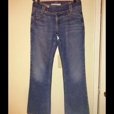 """Tommy Hilfiger hipster boot cut jeans size 2petite Great pair of jeans, size 2petite. Waist measures 15"""" across, LENGHT is 39"""" inseam is 29"""", excellent condition Tommy Hilfiger Jeans Boot Cut"""