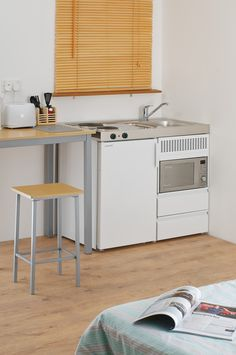 B-100-sMos-RK Economy mini kitchen with 20ltr combi oven, A+ rated fridge, and hotplates | Elfin Kitchens