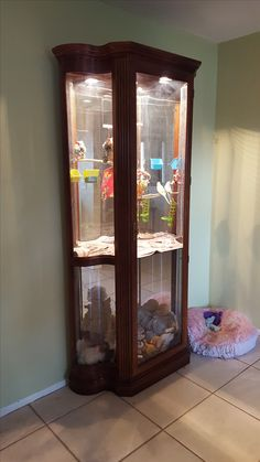 My husband made me a parakeet cage out of a china cabinet. The cabinet had curved glass on the sides and one side was broken. He put in mesh, one wooden shelf so I could still use the bottom added perches etc. = beautiful bird cage!
