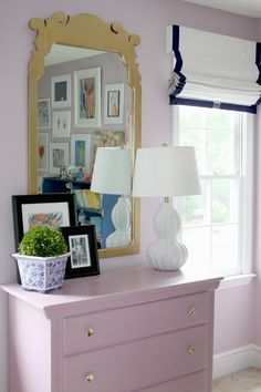 Trimmed roman shades are a lovely addition to a girls room