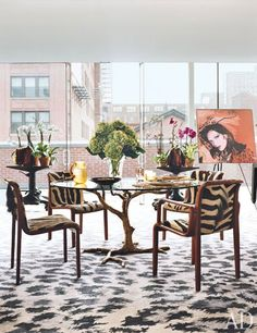A portrait of the designer by Andy Warhol is displayed near vintage chairs | archdigest.com