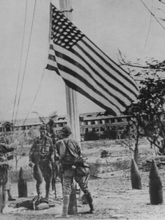 Victorious Japanese Soldiers Taking Down the American Flag on Corregidor