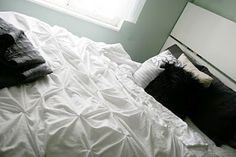 Make your own pin tucked duvet cover... doesn't look too hard.  Now who wants to lend me their sewing machine? :)