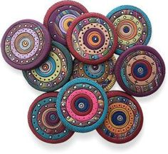 """Alaska's Katie Way readies these polymer magnets for her first spring show. Katie uses a """"cut out and replace"""" process then adds texture and color. You can get a better sense of her methods by looking at her latest studio shot. Katie stacked th [. Polymer Clay Canes, Polymer Clay Projects, Polymer Clay Creations, Polymer Clay Earrings, Clay Crafts, Clay Art Projects, Filigranes Design, Clay Design, Clay Tutorials"""