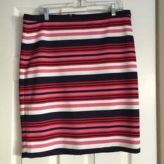"""The Limited striped skirt Super cute striped skirt from The Limited. It's navy, white, pink and red. Size 14 but it fits more like a 12. It's stretchy material but not thin. Love that the thickness hides flaws. I'm 5'6"""" and it hits me to the knee. Very versatile. Can be dressed up for work or worn with a tee for hanging out. Machine washable. The Limited Skirts Midi"""